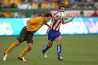 Los Angeles Galaxy's Todd Dunivant heads the ball from Chivas USA'S Matt Taylor in the first half at the Home Depot Center in Carson, CA on Saturday, July 16, 2005..(Matt A. Brown/ISI)