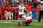Erik Powell, Washington State University kicker, prepares to drill one of his three field goals with the help of holder Kaleb Fossum during the Cougars first road test of the season against Big Ten foe Rutgers at High Point Solutions Stadium in Piscataway, New Jersey, on September 12, 2015.  WSU came back from a late deficit to go on a 90 yard touchdown drive to score the winning TD with 13 seconds left to get the win, 37-34.