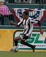 Rochester Rhinos defender TJ Gore (20) brings the ball forward. In a Third Round U.S. Open Cup match, the Chicago Fire defeated the Rochester Rhinos, 1-0, at Sahlens Stadium on June 28, 2011.