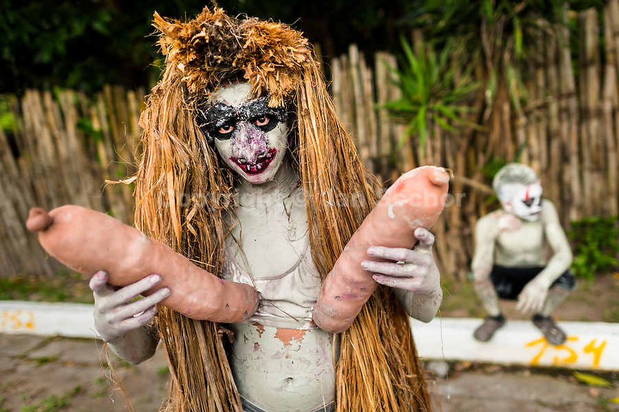 A young Salvadoran man, painted an ashen grey and wearing a mask, performs an indigenous mythology character in the La Calabiuza parade at the Day of the Dead festivity in Tonacatepeque, El Salvador, 1 November 2016. The festival, known as La Calabiuza since the 90s of the last century, joins Salvador's pre-Hispanic heritage and the mythological figures (La Sihuanaba, El Cipitío, La Llorona etc.) collected from the whole Central American region, together with the catholic All Saints Day holiday and its tradition of honoring the dead relatives. Children and youths only, dressed up in scary costumes and carrying painted carts, march from the local cemetery to the downtown plaza where the party culminates with music, dance, drinking and eating pumpkin (Ayote) with honey.