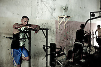 Images from the old Havana, Cuba, Latin America.  ..An old Havana gym full of people on Friday before noon.  A simple walk around the city will highlight a great majority of bodies well taken care of, perhaps driven by a life that for sure involves a lot more walking and very little sitting in front of the computer.  ..The gym, very bared bone, demonstrated creativity and ingenuity in how  out of old parts they have recreated training machines.