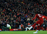 30th October 2019; Anfield, Liverpool, Merseyside, England; English Football League Cup, Carabao Cup, Liverpool versus Arsenal; Divock Origi of Liverpool fires his penalty past Emiliano Martinez of Arsenal during the penalty shootout - Strictly Editorial Use Only. No use with unauthorized audio, video, data, fixture lists, club/league logos or 'live' services. Online in-match use limited to 120 images, no video emulation. No use in betting, games or single club/league/player publications