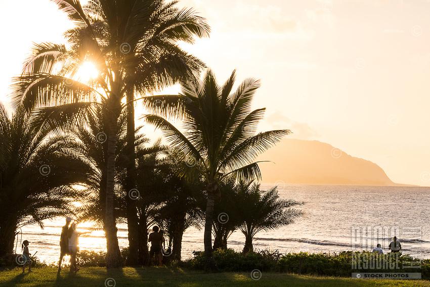 People watch the sun setting at Hale'iwa Ali'i Beach Park, North Shore, O'ahu.