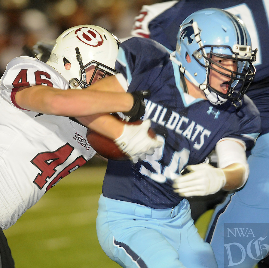 NWA Media/ J.T. Wampler - Har-Ber High School's Luke Hannon tries to shake Springdale's Sam Robinson Friday Oct. 3, 2014.