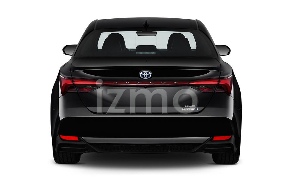 Straight rear view of a 2019 Toyota Avalon XLE Hybrid 4 Door Sedan stock images