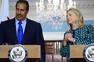 January 11, 2012  (Washington, DC)  U.S. Secretary of State Hillary Rodham Clinton and Qatari Foreign Minister Sheikh Hamad bin Jassim bin Jabor Al Thani listen to a question from the press in the Treaty Room at the State Department in Washington after a bilateral meeting.  (Photo by Don Baxter/Media Images International)
