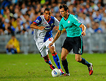 Fernando Recio of Kitchee FC in action against Chris Samba of Blackburn Rovers during the Asia Trophy pre-season friendly match at the Hong Kong Stadium on July 30, 2011 in So Kon Po, Hong Kong. Photo by Victor Fraile / The Power of Sport Images