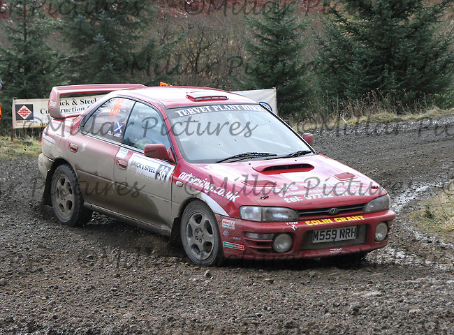 Colin Grant - Mike Cruikshank in a Subaru Impreza at Junction 8 on Special Stage 5 Buck Fell on the Brick & Steel Border Counties Rally 2014, Round 2 of the RAC MSA Scottish Rally Championship sponsored by ARR Craib Transport Limited and other championships  and organised by Whickham & District and Hawick & Border Car Clubs and based in Jedburgh and held in Kielder Forest on 22.3.14.