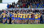 The Sixmilebridge team stand for the anthem before their win over Clooney-Quin in the senior county final replay at Cusack park. Photograph by John Kelly.