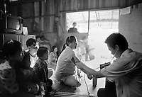 A volunteer health worker visits a woman with AIDS near Chiang Mai in northern Thailand on October 5, 2000. Worldwide, more than 20 million people have died since the first cases of AIDS were identified in 1981.