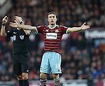 West Ham's Mark Noble complains about an elbow from Manchester United's Robin Van Persie<br /> <br /> Barclays Premier League- West Ham United vs Manchester United  - Upton Park - England - 8th February 2015 - Picture David Klein/Sportimage
