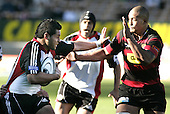 Niva Ta'auso looks to fend off Mose Tuiali'i during the Ranfurly Shield challenge against Canterbury at Jade Stadium on the 10th of September 2006. Canterbury won 32 - 16.