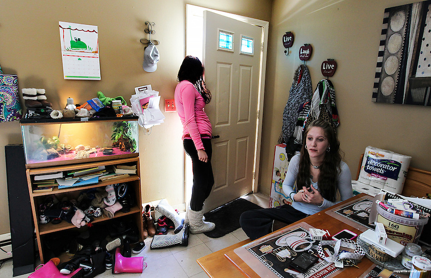 Bennington, VT -  Thursday, Jan. 30, 2014:   Recovering addict Hailey Clark, 20, left, keeps the door open a crack so that she can smoke. Clark was one of many people arrested in the State's largest drug sweep.  Clark lives  with friend and fellow recovering addict Stacey Brandmeyer, right, 22, in a public housing apartment.<br />   <br /> Gov. Peter Shumlin devoted his entire state of the state address in January to what he called a &quot;full-blown heroin crisis&quot; in Vermont, where twice as many people died of heroin overdoses in 2012 as in the year before. Mr. Shumlin's address focused new attention on the problem, which has hit every corner of the state.  <br /> <br /> CREDIT: Cheryl Senter for The New York Times