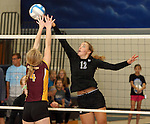 SIOUX FALLS, SD - SEPTEMBER 18: Paige DeJong 12 from Sioux Falls Christian tips the ball past McKenna Mathiesen #4 from Harrisburg in the third game of their match Thursday night at Sioux Falls Christian. (Photo by Dave Eggen/Inertia)