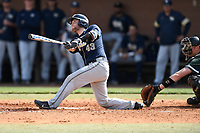Catcher Cole MacLaren (43) of the Pittsburgh Panthers bats in a game against the University of South Carolina Upstate Spartans on Saturday, February 24, 2018, at Cleveland S. Harley Park in Spartanburg, South Carolina. The catcher is Charlie Carpenter. Pittsburgh won, 3-1. (Tom Priddy/Four Seam Images)
