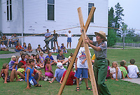 Children watch attentively while a ranger demonstrates how the Brreeches Buoy rope was made to go taught at the Glen Haven Life Saving Station Museum in Slleping Bear Dunes National Lakeshore in Leelanau County, Michigan