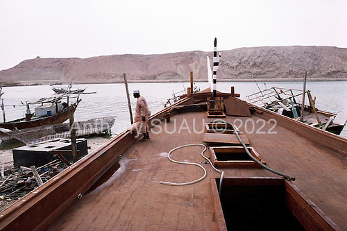 Sur, Oman<br /> July 2001<br /> <br /> A Dhow builder on the deck of a ship nearly complete.