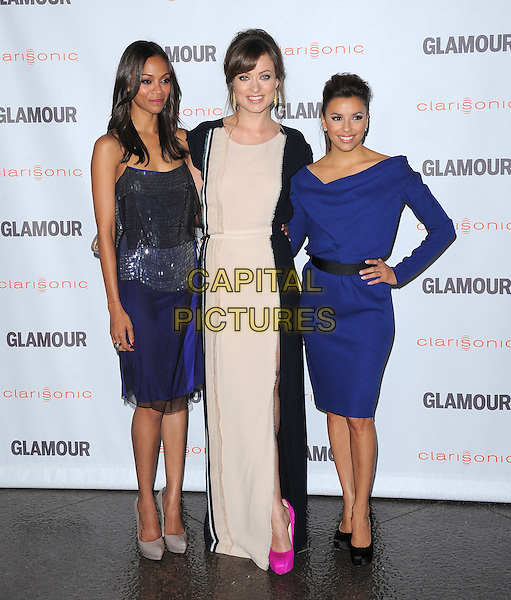 Zoe Saldana, Olivia Wilde and Eva Longoria  .The Glamour Reel Moments held at The Directors Guild of America in West Hollywood, California, USA..October 24th, 2011.full length dress blue black belt shoes hand on hip blue silver white cream maxi slit split pink shoes.CAP/RKE/DVS.©DVS/RockinExposures/Capital Pictures.