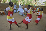 Children dance during Catholic Mass in Gidel, a village in the Nuba Mountains of Sudan. The area is controlled by the Sudan People's Liberation Movement-North, and frequently attacked by the military of Sudan.