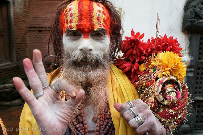 sadhu in Pashupatinath, Kathmandu, Nepal, September 2011. Follower of Vishnu (next supreme god Shiva, who is mainly adored in Pashupatinath)