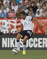 USWNT substitute forward Abby Wambach (20) passes the ball.  In an international friendly, the U.S. Women's National Team (USWNT) (white/blue) defeated Korea Republic (South Korea) (red/blue), 4-1, at Gillette Stadium on June 15, 2013.