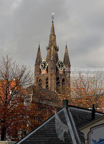 Delft, Netherlands - November 5, 2007 -- The tower of the Oude Kerk (Old Church), the oldest Church in Delft, Netherlands.  It was built in 1246. Famous Dutchmen including Piet Hein, Maerten Tromp and Johannes Vermeer are buried in this church..Credit: Ron Sachs / CNP