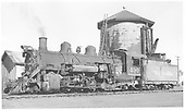 3/4 fireman side view of K-37 #490 at Antonito with water tank in background.  Built by Baldwin as #1014 in 1902 and rebuilt ast #490 in 1928.<br /> D&amp;RGW  Antonito, CO  7/1958