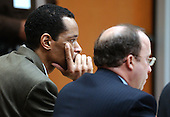Sniper suspect John Allen Muhammad, left, listens to proceedings along with his attorney Peter Greenspun during his trial in courtroom 10 at the Virginia Beach Circuit Court in Virginia Beach, Virginia on October 27, 2003.<br /> Credit: Davis Turner - Pool via CNP