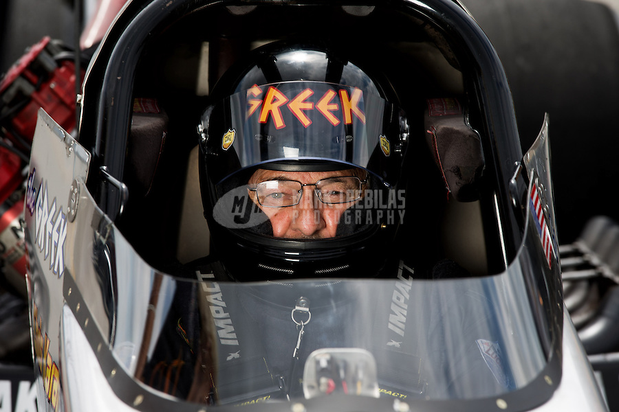 Sept. 1, 2013; Clermont, IN, USA: NHRA top fuel dragster driver Chris Karamesines during qualifying for the US Nationals at Lucas Oil Raceway. Mandatory Credit: Mark J. Rebilas-
