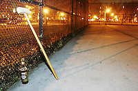 "People playing the sport of ""urban bike polo"" in Brooklyn, NY on March 10, 2004 on a traditional handball court."
