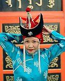 MONGOLIA, Ulaanbaatar, woman performer of traditional Mongolian dance in front of the Abtai-Sain Khan Palace