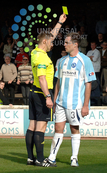 Toe to toe! Iain Campbell of Forfar Athletic goes toe to toe with referee Steven McLean as he receives a yellow card during the game against Ayr United...Scottish Football League Division 2 match at Somerset Park, Ayr - 2/4/11...All pictures must be credited to www.universalnewsandsport.com. (Office: 0844 884 51 22)