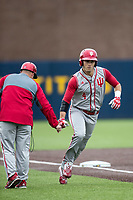 Indiana Hoosiers second baseman Tony Butler (4) rounds third base after hitting a leadoff home run against the Michigan Wolverines during the NCAA baseball game on April 21, 2017 at Ray Fisher Stadium in Ann Arbor, Michigan. Indiana defeated Michigan 1-0. (Andrew Woolley/Four Seam Images)