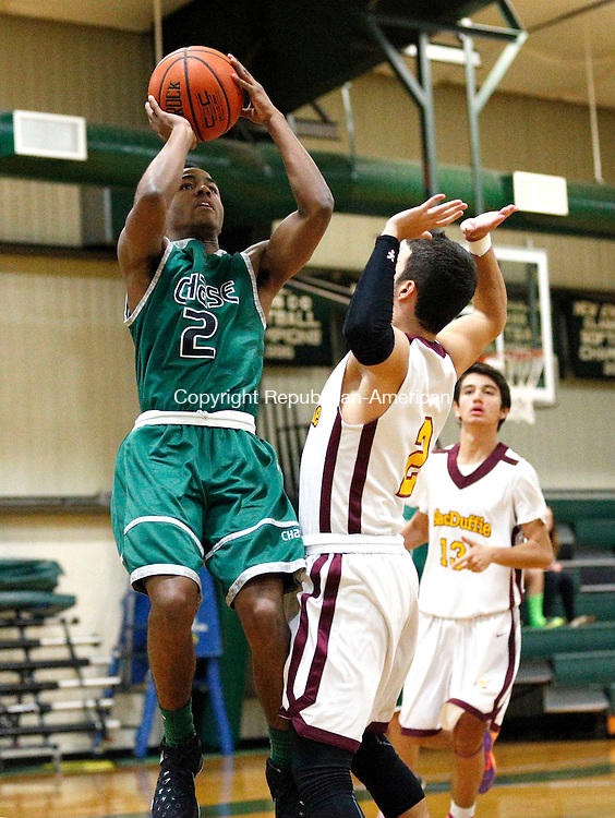 Waterbury, CT- 09 January 2016-010916CM01- Chase Collegiate's Blake Hardy, takes a shot over MacDuffie's Victor Godoy during their prep school matchup in Waterbury on Saturday.      Christopher Massa Republican-American