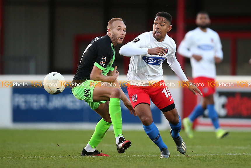 Angelo Balanta of Dagenham and Lois Maynard of Stockport during Dagenham & Redbridge vs Stockport County, Vanarama National League Football at the Chigwell Construction Stadium on 8th February 2020