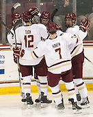 Zach Sanford (BC - 24), Alex Tuch (BC - 12), Adam Gilmour (BC - 14), Noah Hanifin (BC - 7), Ian McCoshen (BC - 3) - The Boston College Eagles defeated the visiting Merrimack College Warriors 2-1 on Wednesday, January 21, 2015, at Kelley Rink in Conte Forum in Chestnut Hill, Massachusetts.
