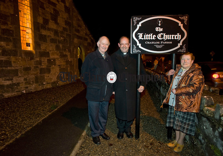 Bishop of Limerick Donal Murray, PP Fr. Liam Enright and sacristian Ita Cusack unveil their new sign at the celebratory mass for the 150 year anniversary of the Little Church Sixmilebridge in Cratloe Parish. Photograph by John Kelly.