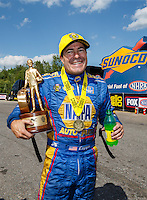 Jun 6, 2016; Epping , NH, USA; NHRA funny car driver Ron Capps celebrates after winning the New England Nationals at New England Dragway. Mandatory Credit: Mark J. Rebilas-USA TODAY Sports
