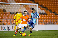 Myles Weston of Wycombe Wanderers under pressure from Sebastien Des Pres of Blackpool during the The Checkatrade Trophy match between Blackpool and Wycombe Wanderers at Bloomfield Road, Blackpool, England on 10 January 2017. Photo by Andy Rowland / PRiME Media Images.