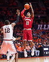 Jan 24, 2018; Champaign, IL, USA; Indiana Hoosiers guard Devonte Green (11) shoots defended by Illinois Fighting Illini forward Leron Black (12) during the second half at State Farm Center. Mandatory Credit: Mike Granse-USA TODAY Sports