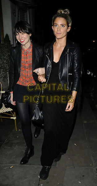 guest &amp; Katie Waissel<br /> The Big Smoke new PR company launch party, Sanctum Soho Hotel, London, England.<br /> September 18th, 2013<br /> full length black top jacket skirt tights leather jacket red dress<br /> CAP/CAN<br /> &copy;Can Nguyen/Capital Pictures