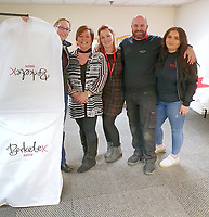 "COPY BY TOM BEDFORD<br /> Pictured L-R: Bride to be Megan Stamp with staff members Jo Williams, Michelle Curry, Adam Bowdidge and Lara Williams at the John Pye Auctions warehouse in Pyle, south Wales, UK.<br /> Re: A bride cried tears of joy after her missing wedding dress was found among a pile of 20,000 gowns in a warehouse.<br /> Meg Stamp, 27, paid £1,300 for the beautiful ivory lace dress but it  was seized by liquidators after a bridal company went bust.<br /> It was boxed up along with 20,000 others and due to be sold for a knock-down price at auction.<br /> But determined Meg banged on the auctioneer door saying: ""I want my dress back"".<br /> Staff at John Pye auctioneers in Port Talbot spent three hours sifting through boxes until they finally found Meg's dream dress."