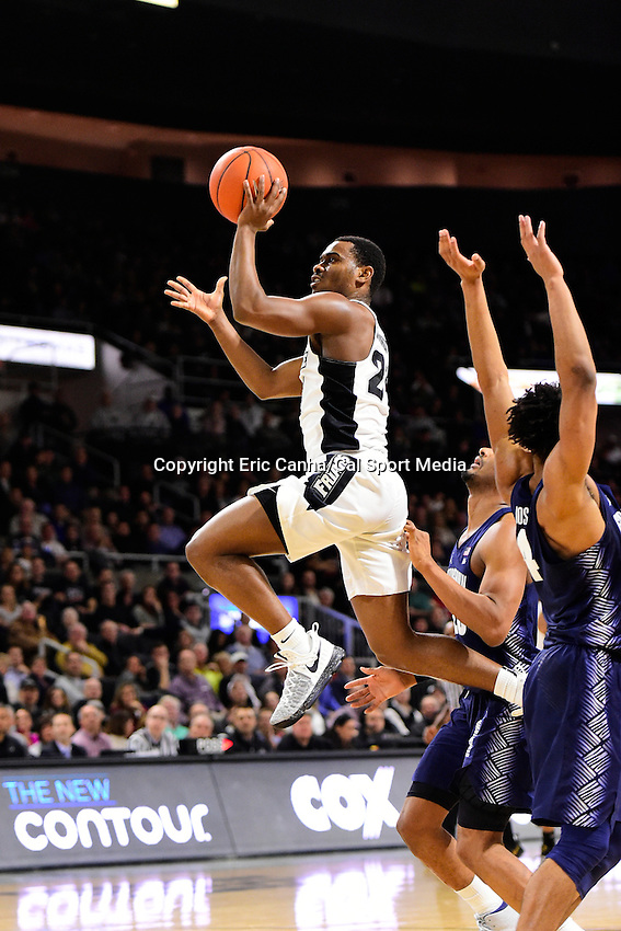 Wednesday, January 4, 2016: Providence Friars guard Kyron Cartwright (24) drives to the basket during the NCAA basketball game between the Georgetown Hoyas and the Providence Friars held at the Dunkin Donuts Center, in Providence, Rhode Island. Providence defeats Georgetown 76-70 in regulation time. Eric Canha/CSM