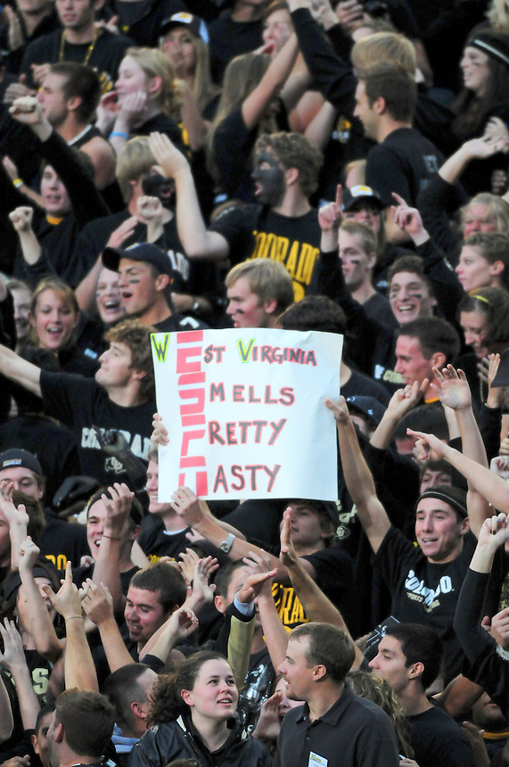 """18 September 08: Colorado Buffaloes fans show their feelings about the opposing team, the West Virginia Mountaineers, and try to get the ESPN camera operators to put them in the broadcast. The fans all dressed in black clothing for the annual """"black out"""" of Folsom Field. The Colorado Buffaloes defeated the West Virginia Mountaineers 17-14 in overtime at Folsom Field in Boulder, Colorado. For Editorial Use Only."""