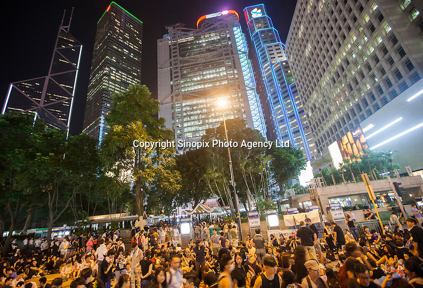 Occupy Central pro-democracy protesters are seen on the second day of the mass civil disobedience campaign Occupy Central, Central District, Hong Kong, China, 30 September 2014. The movement is also being dubbed the 'umbrella revolution' after the versatile umbrellas used to shield protesters from rain, sun - and police pepper spray.