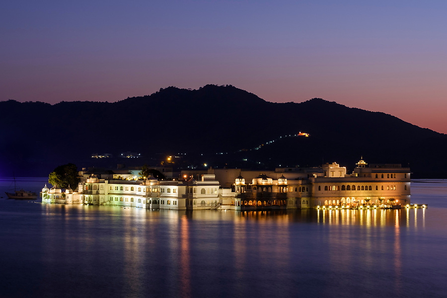 UDAIPUR, INDIA - CIRCA NOVEMBER 2016:  Lake Palace Hotel formerly known as Jag Niwas at night in Lake Pichola in Udaipur