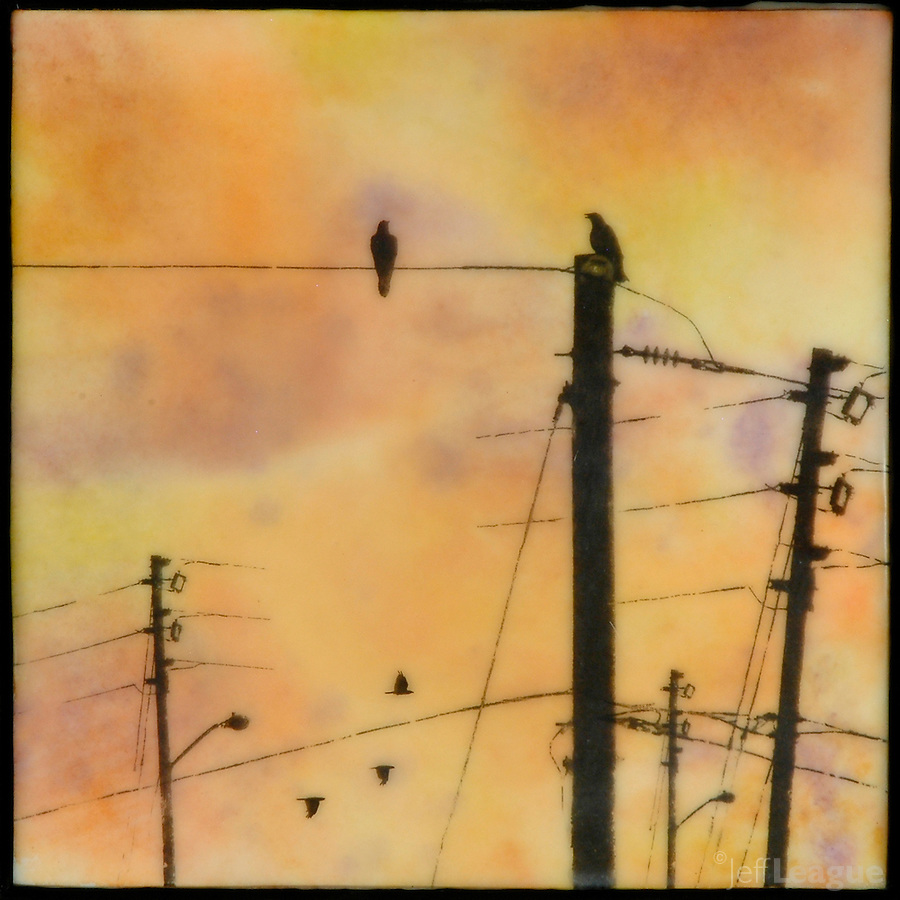 Orange sunset encaustic painting with photo transfer of birds on telephone poles.