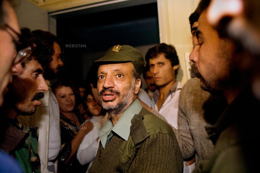 "1983. Lebanon. Tripoli. Portrait of Yasser Arafat (1929-2004), chairman of the PLO, during the Lebanese War (1975-1990), during the siege by the Syrian army of the headquarters of the PLO, settled in Tripoli after the 1982 Invasion of Lebanon (Operation ""Peace for Galilee""). Liban. Tripoli. Portrait de Yasser Arafat (1929-2004), le chef de l'OLP, pendant la Guerre du Liban (1975-1990), lors du siège par l'armée syrienne du quartier général de l'OLP installé à Tripoli après l'invasion du Liban en 1982 (Opération ""Paix en Galilée"")."