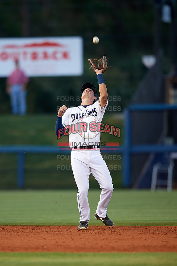 Charlotte Stone Crabs shortstop Tristan Gray (9) catches a pop up during a game against the Palm Beach Cardinals on April 20, 2018 at Charlotte Sports Park in Port Charlotte, Florida.  Charlotte defeated Palm Beach 4-3.  (Mike Janes/Four Seam Images)