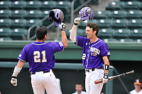 Catcher Danny Bermudez (21) of Western Carolina celebrates with Kramer Ferrell (2) after hitting a home run in the ninth inning against Mercer in the final game of the SoCon Tournament championship series on Sunday, May 29, 2016, at Fluor Field at the West End in Greenville, South Carolina. Western won, 3-2. (Tom Priddy/Four Seam Images)